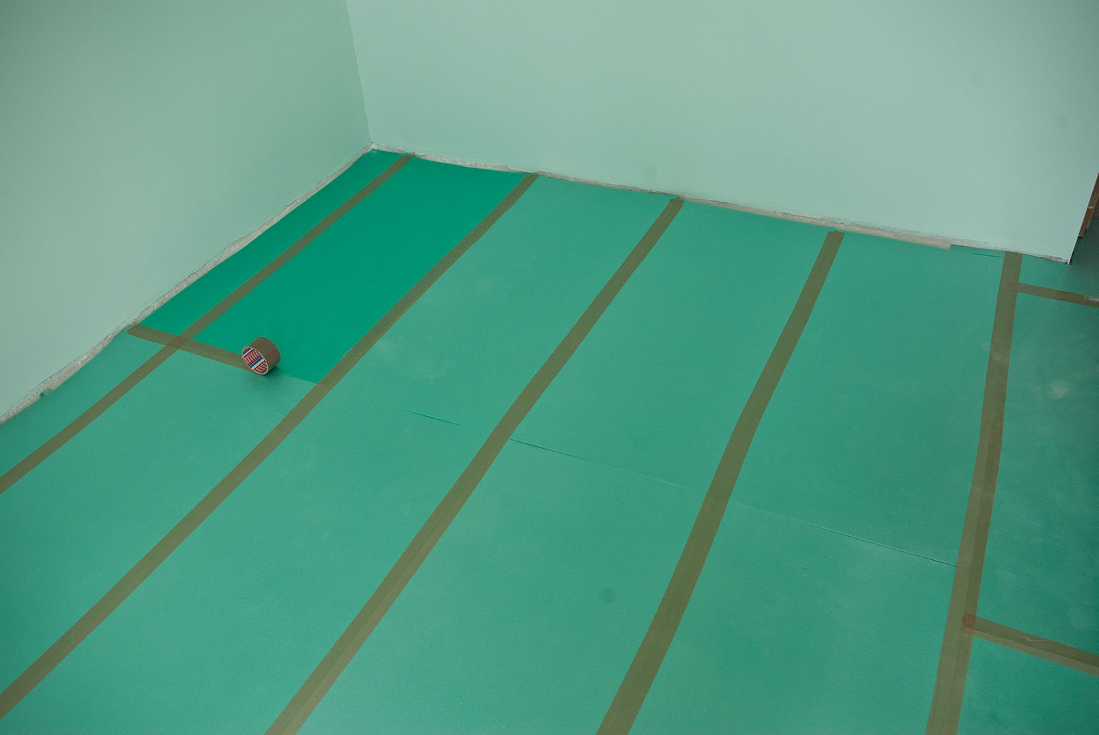 Underlay for laminate flooring with adhesive tape
