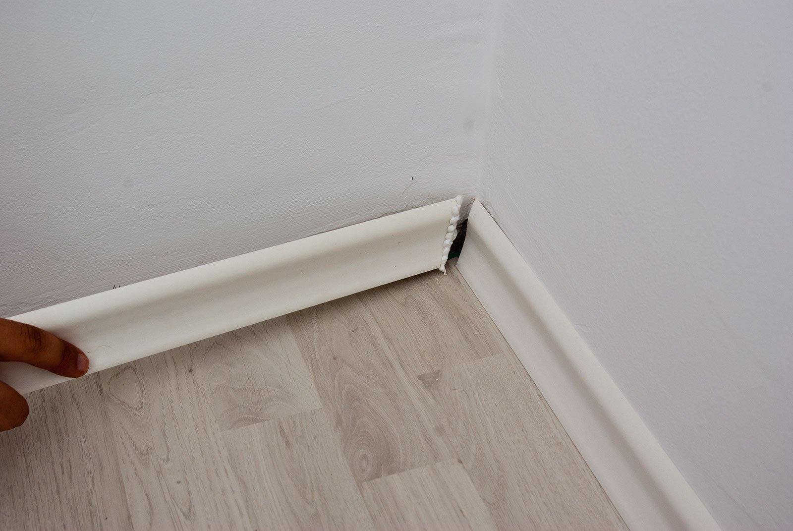 How to cut base molding in place - Joining Baseboard At Corner