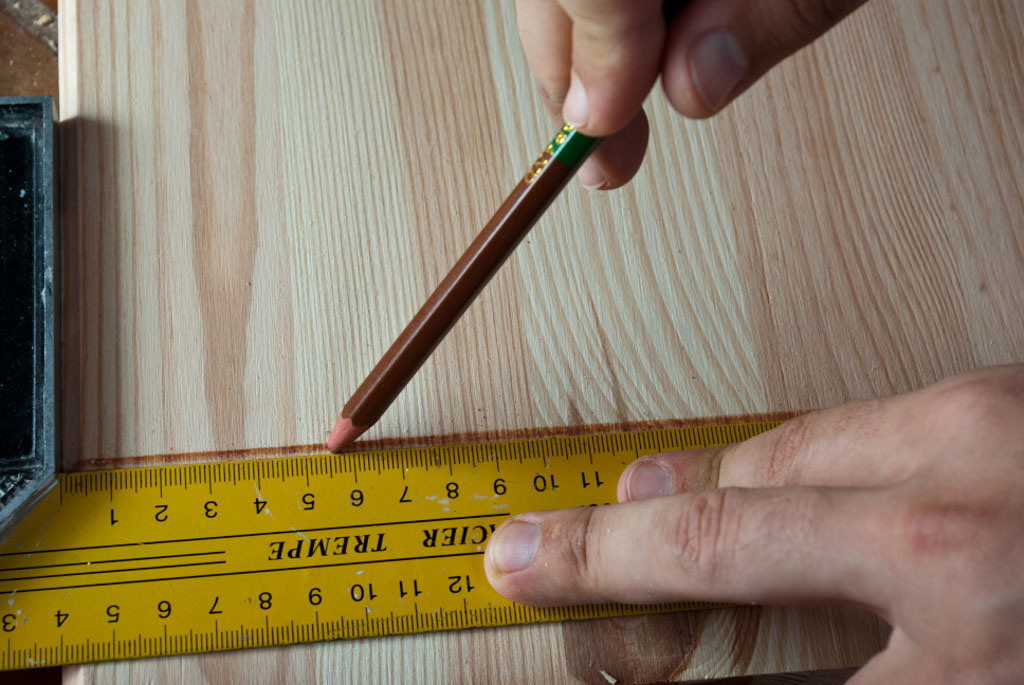 Measuring the shelf space on a wood board