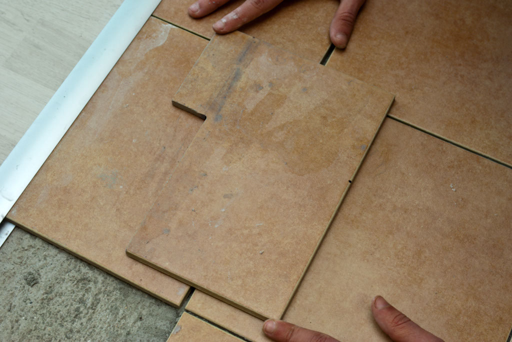 Cut tile for door jamb