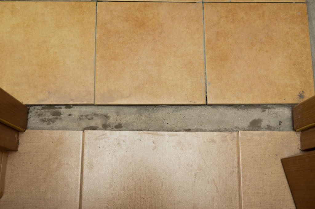 Wall to floor tile transition