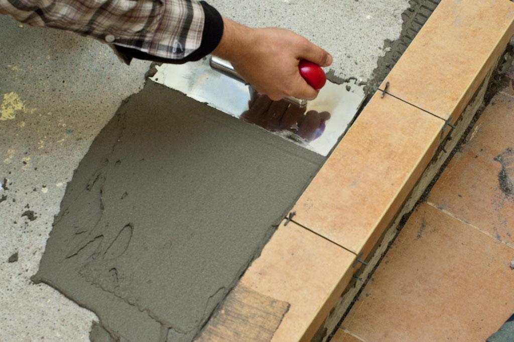 Laying ceramic tiles on concrete floor