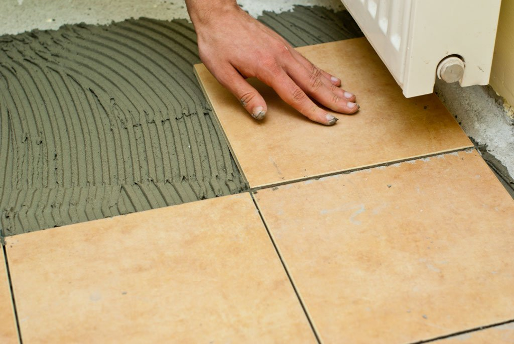 Laying a tile floor on concrete