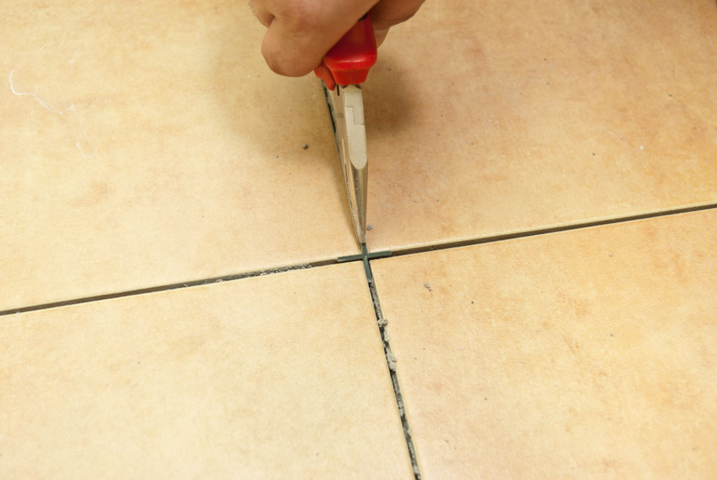 How to remove old grout from floor tiles