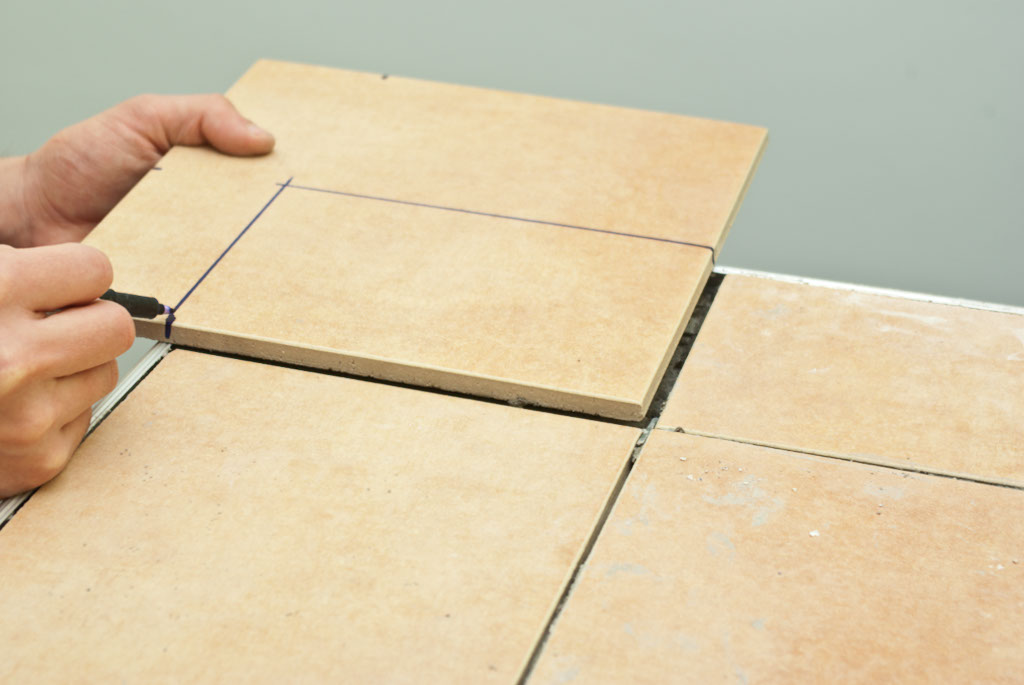 How to cut ceramic tile with a tile cutter