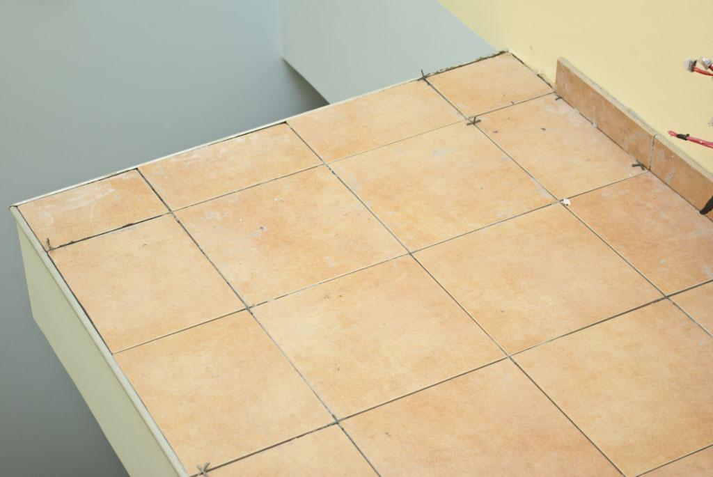 Floor tile fitting