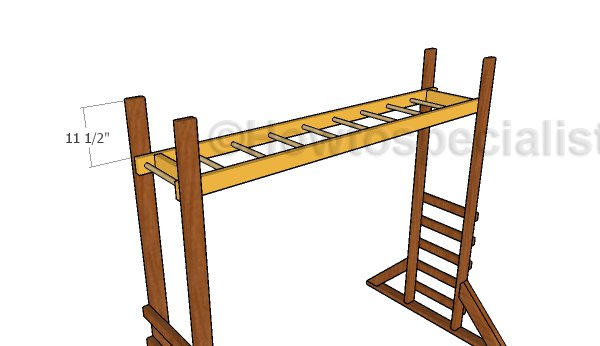Attaching the monkey bars to the stand