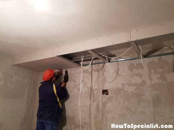 Fitting-the-drywall-sheets-to-the-frame-of-the-soffit-box