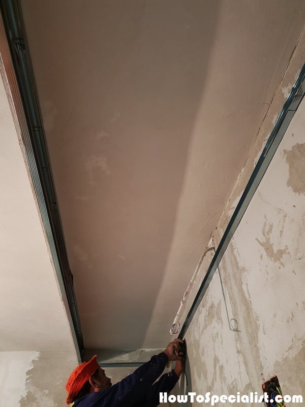 Fitting-the-metal-tracks-for-the-soffit-box