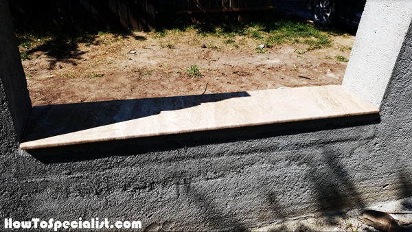 Fitting-the-travertine-capings-to-the-concrete-fence-base