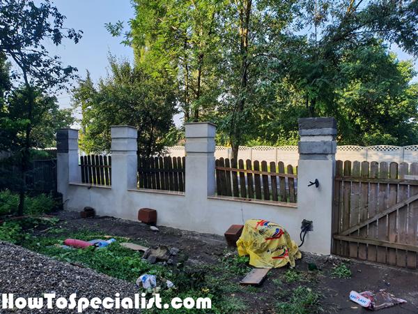 Plastering-the-concrete-fence
