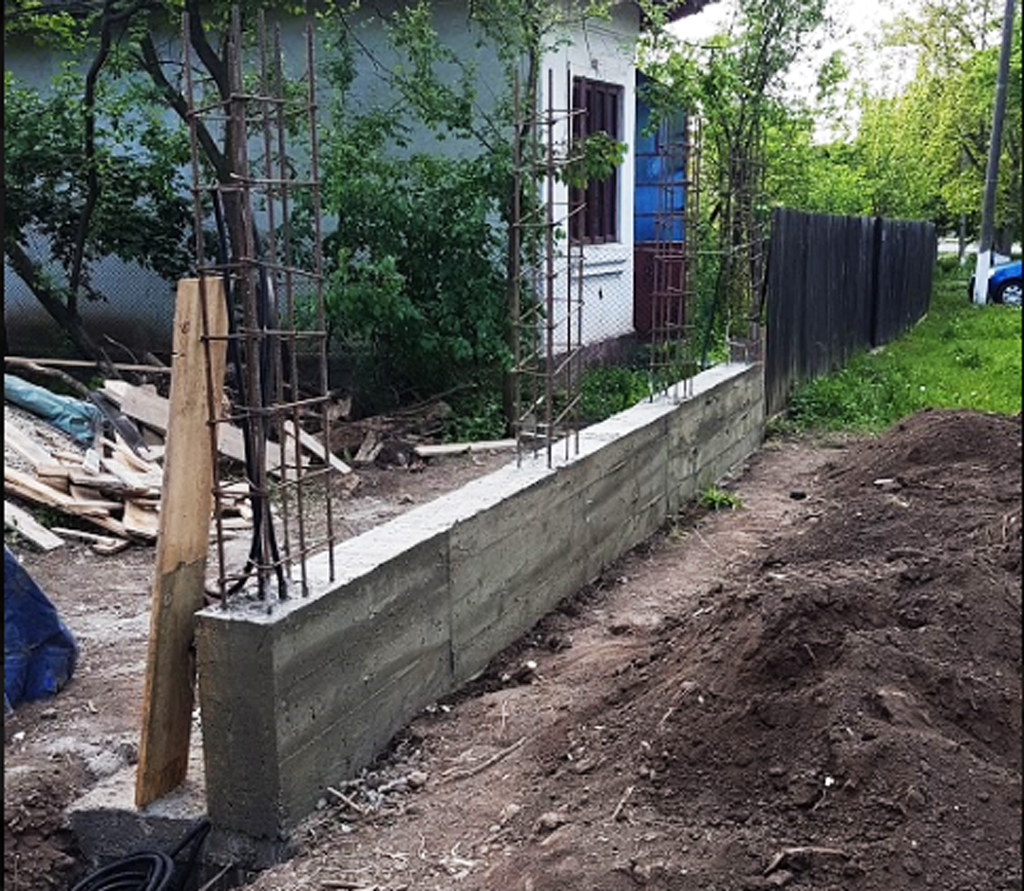 Removing-the-formwork-after-pouring-the-base-of-the-fence
