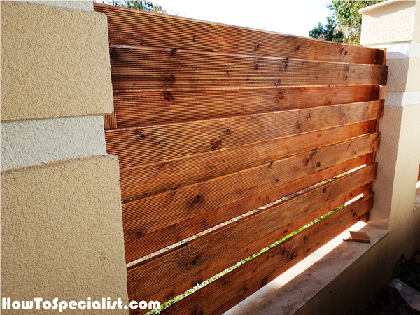 Wooden-panels-for-concrete-fence
